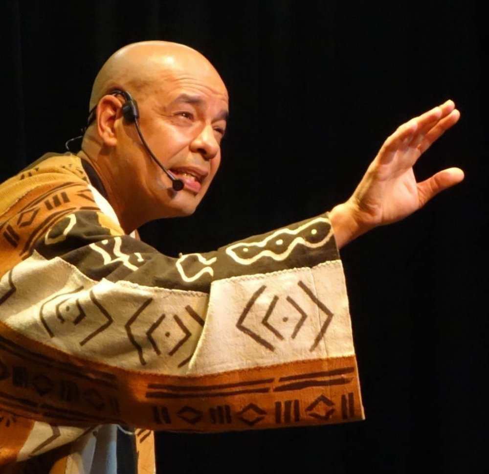 A storyteller in clothing covered with traditional patterns
